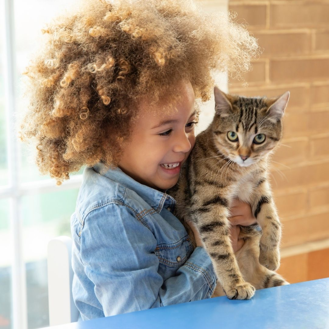 Child Holding her emotional support cat
